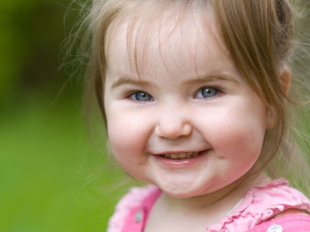 Nice little girl happily smiling