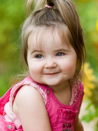 Absolutely positive smile of charming girl