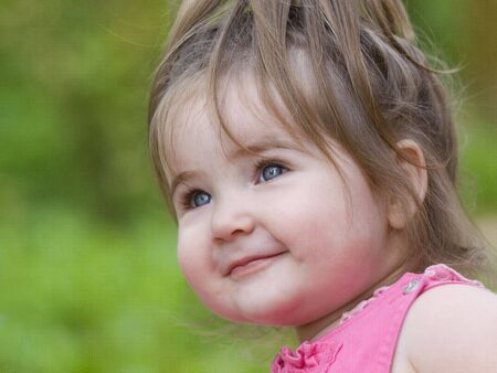 Nice little girl happily smiling Stock Photo - 3487522