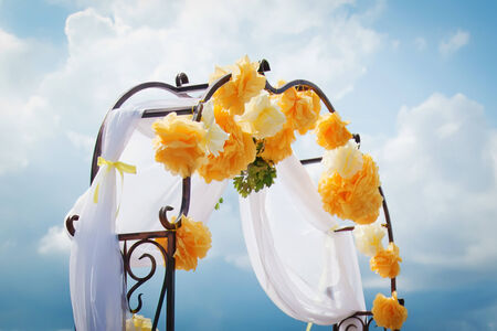 Wedding arch decorated by yellow flowers  Stock Photo