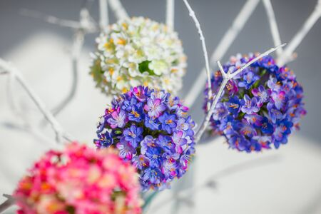 Round decorative flower balls of white, blue and pink colors