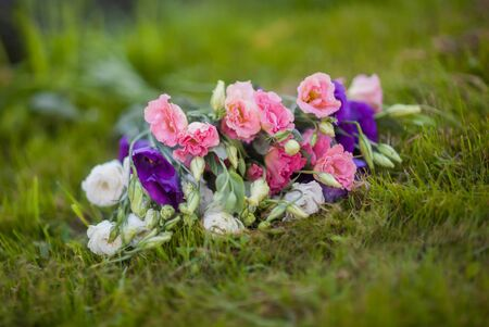 Tender bouquet of Eustoma on the green grass Stock Photo