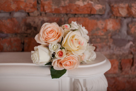 Rose bouquet on the white shelf Stock Photo