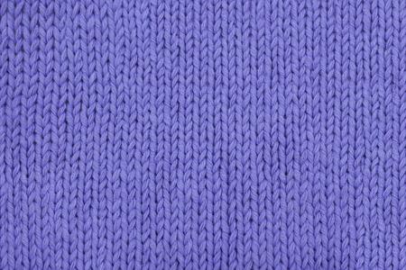 テクスチャのクローズ アップを編み物抽象的なラベンダー。メリヤス編み。表編みします。
