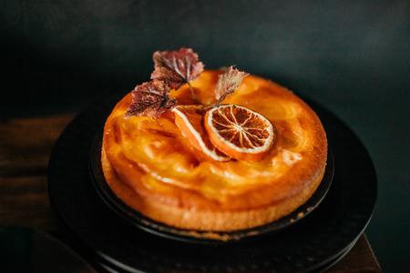 Tasty pumpkin pie on dark table