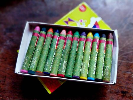 A brand new wax crayon box with all the colors in place