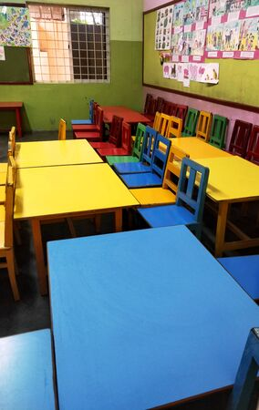 Chennai,TamilNaduIndia-02082019: Colorful elementary school bench and desk with no children