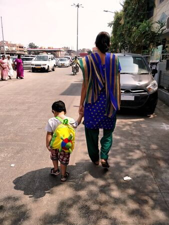Chennai,TamilNaduIndia-12022018: A mother taking her son to school by walk on monday morning