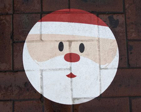 footpath: Santa Claus face on the footpath brick