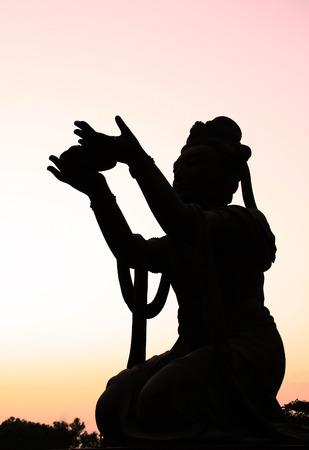 Deva statue around the Giant Buddha at Po Lin Monastery photo