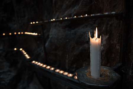 flickering: Prayer candles light up the darkness in a church