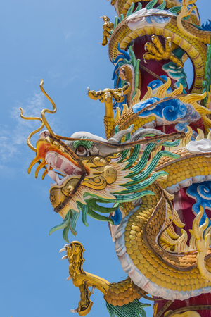 former years: Dragon statue on pole with cloud like fuming dragon.