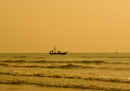 back home: Silhouette of fisherman coming back home. hua hin Thailand. Stock Photo