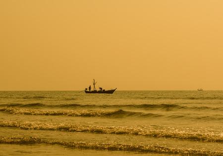 hua hin: Silhouette of fisherman coming back home. hua hin Thailand. Stock Photo
