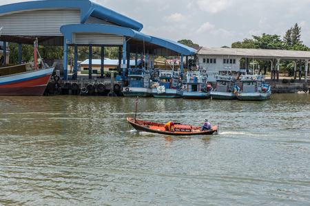 unstable: Unstable small wooden fisherman boat makes it way back into port, Rayong, Thailand. Stock Photo