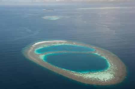 atoll: atoll in Indian ocean view from seaplane, Maldives island.