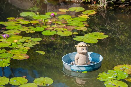 legends folklore: kappa statue in the bucket on the pond. Stock Photo