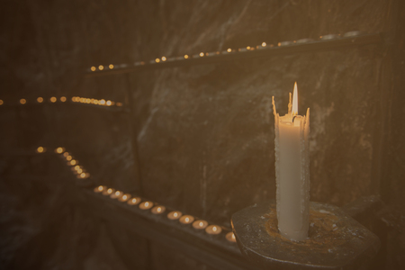 light up: Prayer candle light up the darkness in a church, Vintage tone.