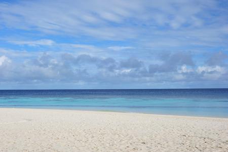 castaway: Sand beach and ocean wave, Maldives Stock Photo