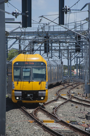 approaches: SYDNEY,AUSTRALIA : A Waratah train approaches Central Station with a local