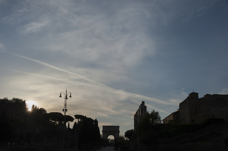 baukunst: The Silhouette of ancient gate area on the Forum Romanum in Rome in Italy