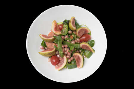 fico: Fig salad with black background.