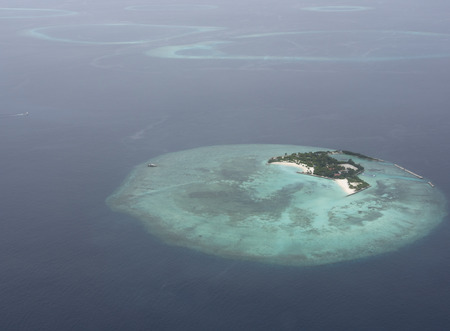 maldivian: Atoll in Maldives from aerial view Stock Photo