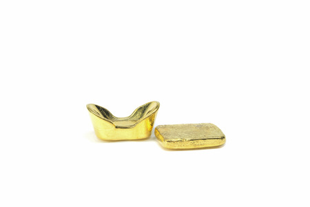 wadded: traditional Chinese ancient gold bullion on white background Stock Photo