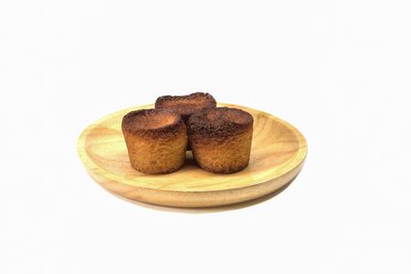 financier: Financier cakes on wooden plate.