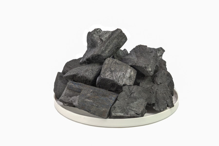 activated: wood charcoal on white background Stock Photo