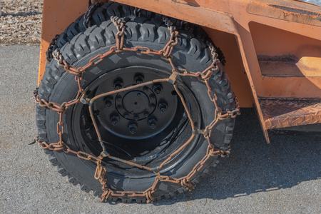 swerve: ice chains on tires. Industrial security for cold weather tool Stock Photo