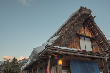 shirakawa go: Before sunset time, Beautiful Facade and triangle roof symbol of The Historic Villages of Shirakawa Shirakawa-go. Shirakawago Traditional Houses in the Gassho Zukuri Style
