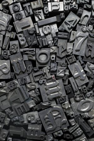 tooled: Various metal letter pieces.
