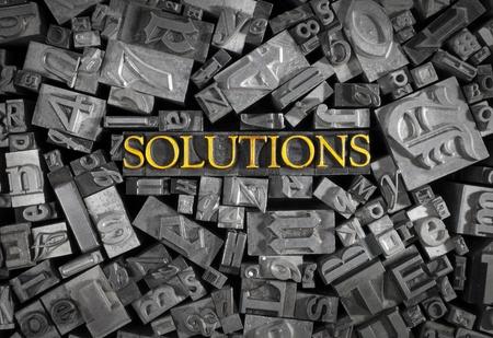 Solutions in a sea of letterpress type.  Archivio Fotografico
