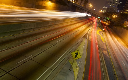 timelapse: A long exposure of a freeway at night in the city. Stock Photo