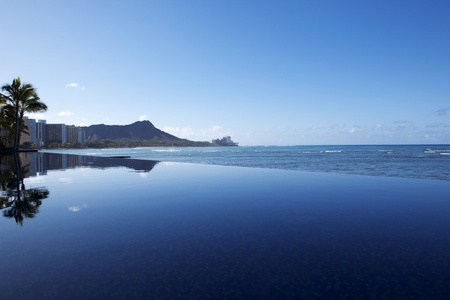 intersects: An infinity pool intersects with the beach overlooking Waikiki.