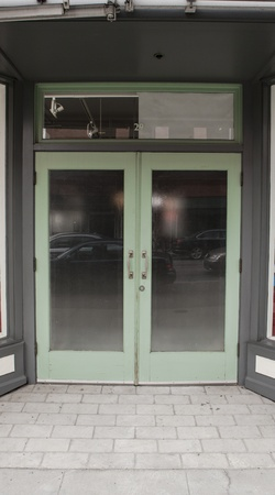 shop front: A glass double door entry on the street