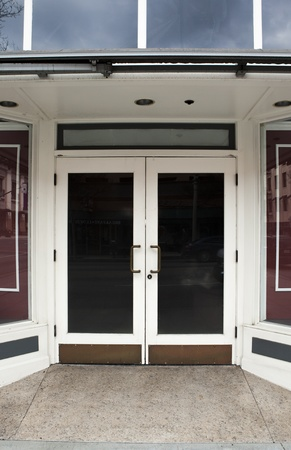 glass door: Closed double glass doors to the entrance of a store