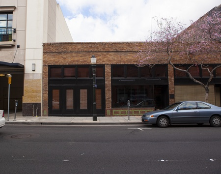 parked: A wide angle street view of retro revial store fronts with brick and stone