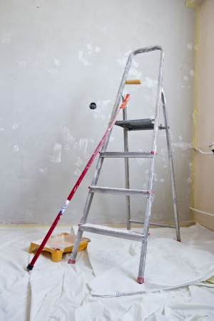 home improvement, dirty paint ladder, roller, brush and tray
