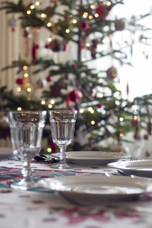 table prepared for christmas dinner to serve