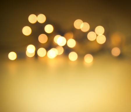 Glowing lights on golden background