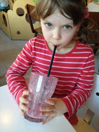 Child drinking fruit mill-shake Stock Photo