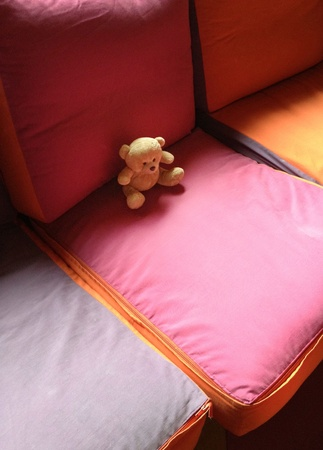 Teddy bear on the sofa Stock Photo