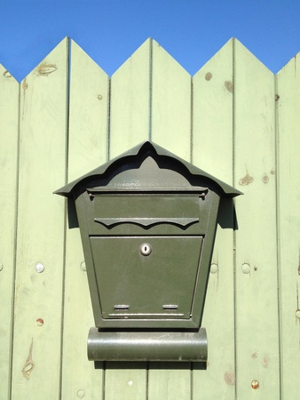Mailbox on wooden fence