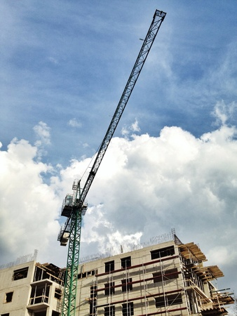 Construction of building with crane Stock Photo