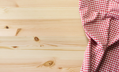 overhead view: tablecloth over wooden table with copy space