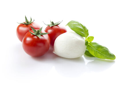 mozzarella cheese: mozzarella with cherry tomatoes and basil, clipping path included Stock Photo