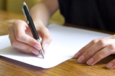 female student writing Standard-Bild