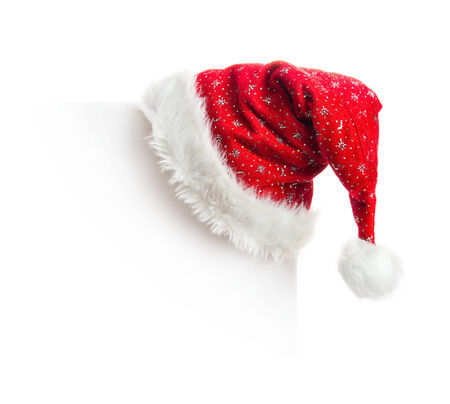 santa claus background: Santa hat hanging on white board